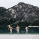 Perfect Landscape in the Middle of Mountains with a Big Lake Three Young Men Are Running To the Lake - VideoHive Item for Sale