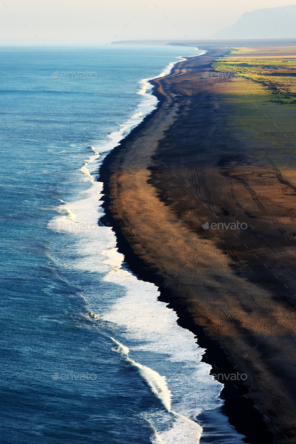 Black beach and Atlantic ocean - Stock Photo - Images
