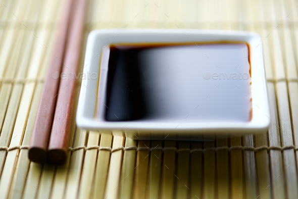 Soy sauce and wooden sticks - Stock Photo - Images