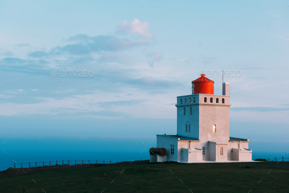 White lighthouse at Cape Dyrholaey - Stock Photo - Images