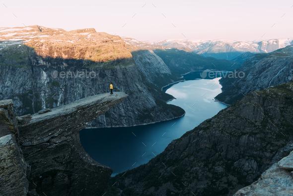 Alone tourist on Trolltunga rock - Stock Photo - Images
