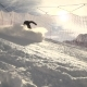 Person Goes Down on Skis to a Snowbord on a Hillside - VideoHive Item for Sale