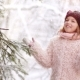Snowfall in the Forest The Girl Puts Her Face Under the Falling Snowflakes - VideoHive Item for Sale