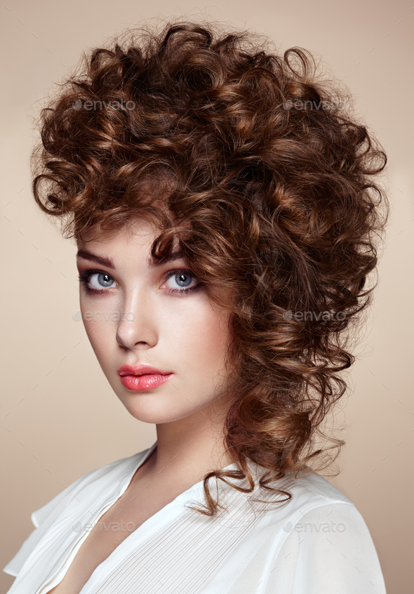 Brunette woman with curly and shiny hair - Stock Photo - Images