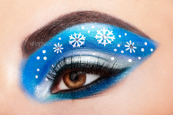 Eye girl makeover snowflakes - Stock Photo - Images