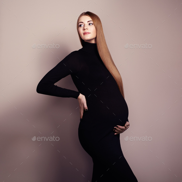 Portrait of the young pregnant woman - Stock Photo - Images