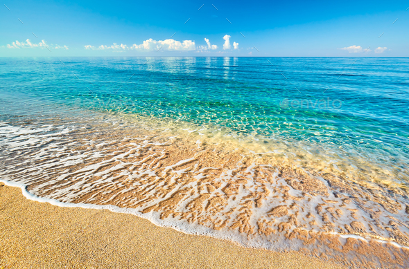 Sea view from tropical beach with sunny sky - Stock Photo - Images