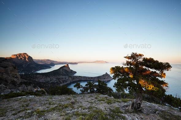 Mountains and sea at sunset - Stock Photo - Images