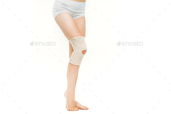 Joint ache, woman with elastic bandage, knee pain - Stock Photo - Images