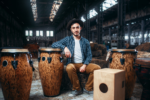 Male drummer pose against african wooden drum - Stock Photo - Images