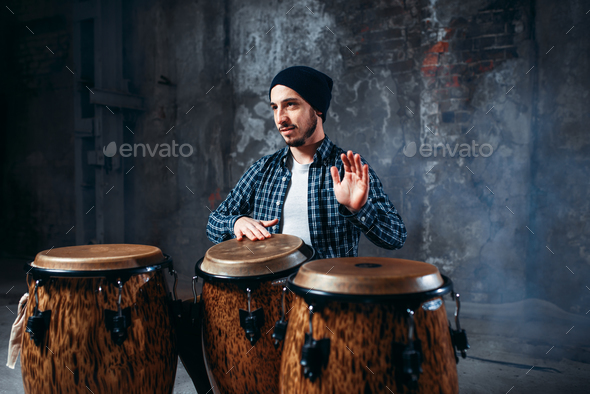 Drummer playing on wooden bongo drums, beat rhythm - Stock Photo - Images