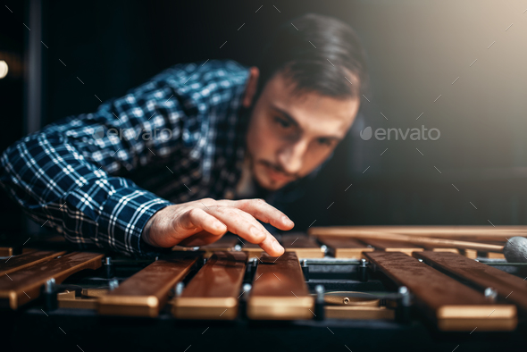 Xylophone player with sticks, musician in action - Stock Photo - Images