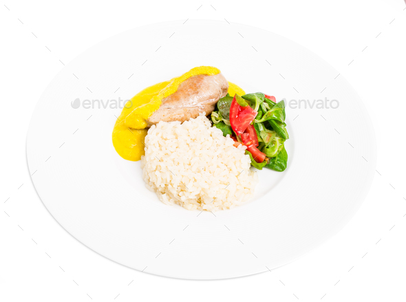 Roasted chicken fillet with saffron mousse. - Stock Photo - Images