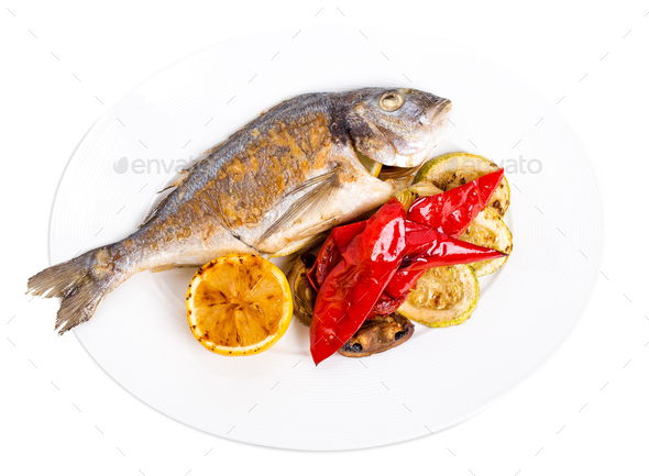 Grilled seabass with vegetables on plate. - Stock Photo - Images