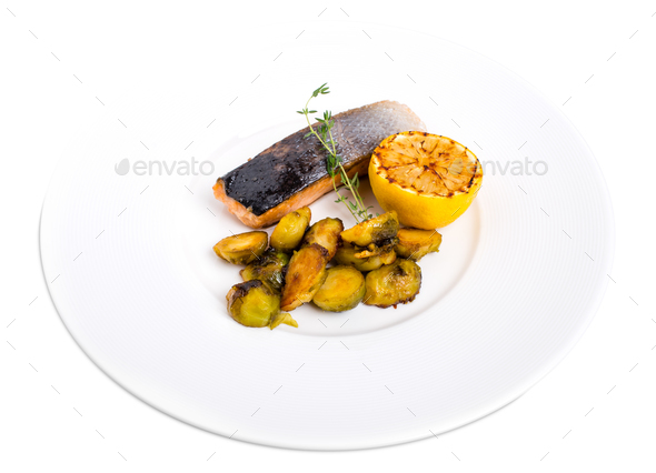 Grilled salmon fillet with brussel sprouts. - Stock Photo - Images