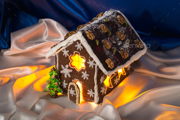 Christmas glazed gingerbread house with sweet pine. - Stock Photo - Images