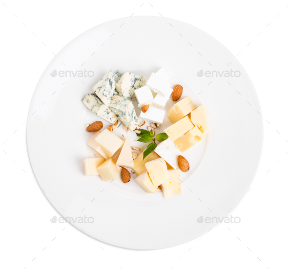 Assorted cheese platter with almonds and mint. - Stock Photo - Images