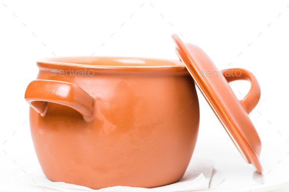 Closeup of orange clay pot. - Stock Photo - Images