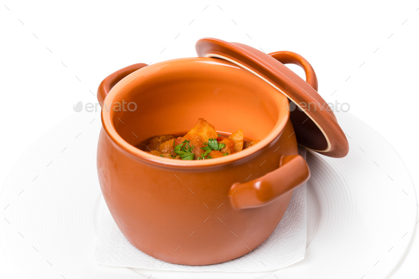 Stewed pork and potatoes in crock pot. - Stock Photo - Images