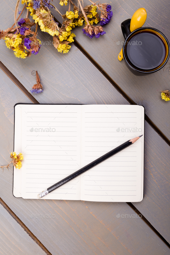Coffee cup and notebook on wooden table. Good morning . - Stock Photo - Images