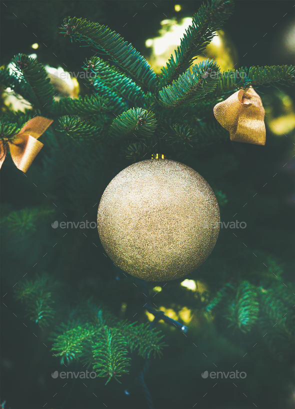 Christmas decoration glittering ball on a fur tree - Stock Photo - Images