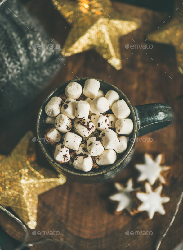 Christmas winter hot chocolate with marshmellows served with light garland - Stock Photo - Images