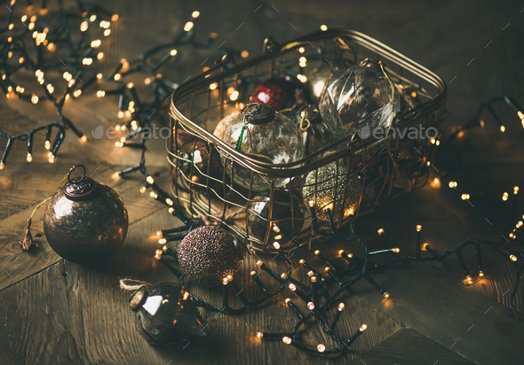 Christmas tree toy decoration balls in box and light garland - Stock Photo - Images