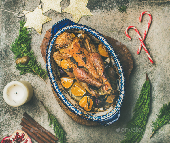 Roasted chicken for Christmas celebration table over grey background - Stock Photo - Images