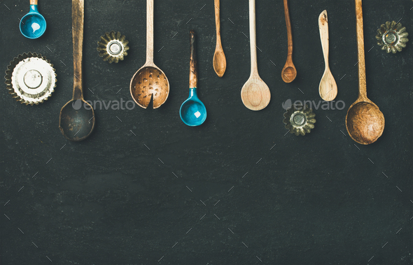 Flat-lay of old vintage kitchen spoons and baking tin molds - Stock Photo - Images