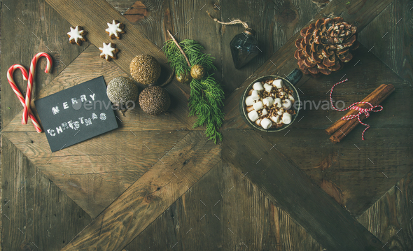 Flat-lay of greeting card, candy cane, hot chocolate, top view - Stock Photo - Images