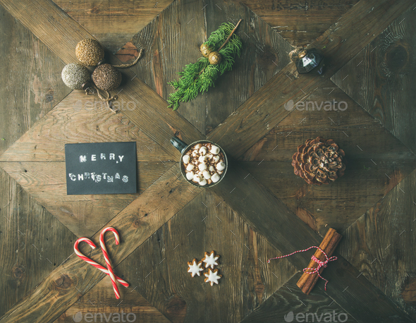 Flat-lay of greeting card, hot chocolate, candy cane, pine cone - Stock Photo - Images