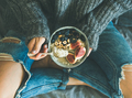 Woman in shabby jeans and sweater eating healthy breakfast - PhotoDune Item for Sale