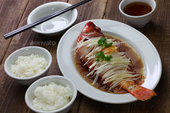 chinese steamed red grouper with ginger, scallions and soy sauce - Stock Photo - Images