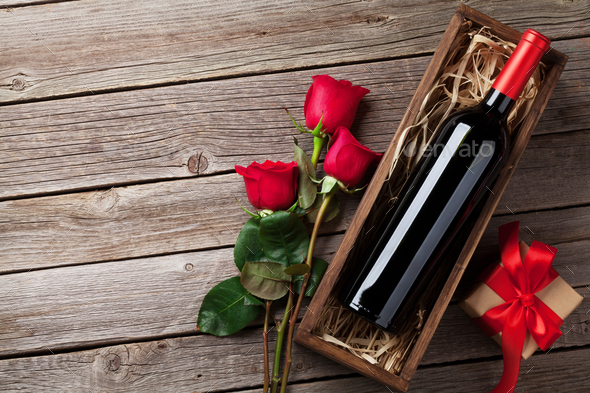 Red rose flowers, wine and gift - Stock Photo - Images