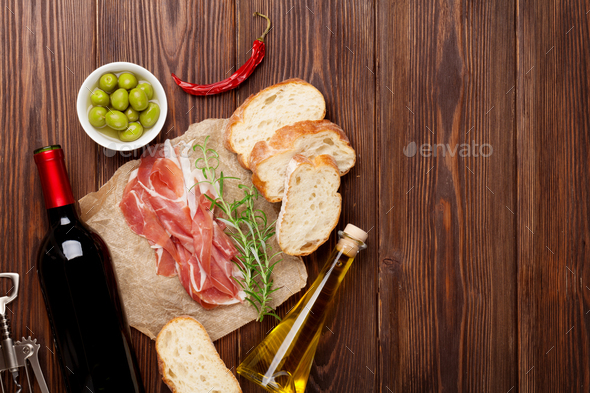 Prosciutto, wine, olives, parmesan and olive oil - Stock Photo - Images
