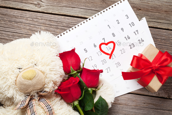 Red rose flowers, bear toy and coffee - Stock Photo - Images