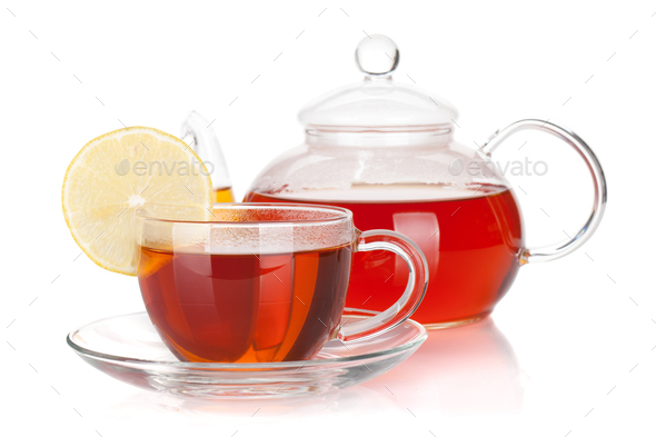Glass teapot and cup of black tea with lemon slice - Stock Photo - Images