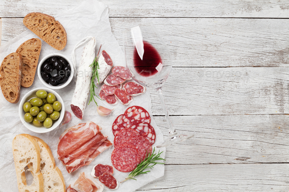 Salami, ham, sausage, prosciutto and wine - Stock Photo - Images