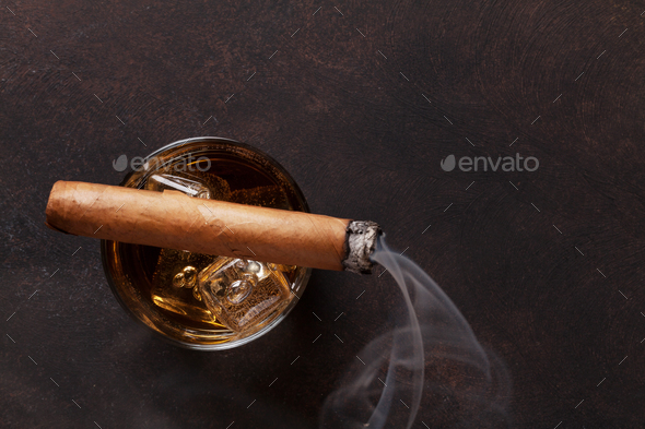 Whiskey with ice and cigar - Stock Photo - Images