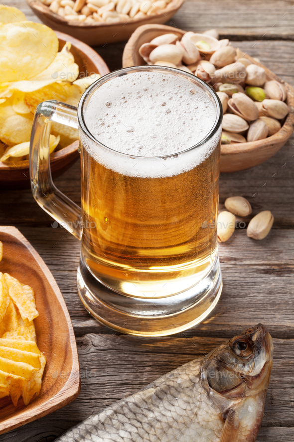 Lager beer mug and snacks - Stock Photo - Images