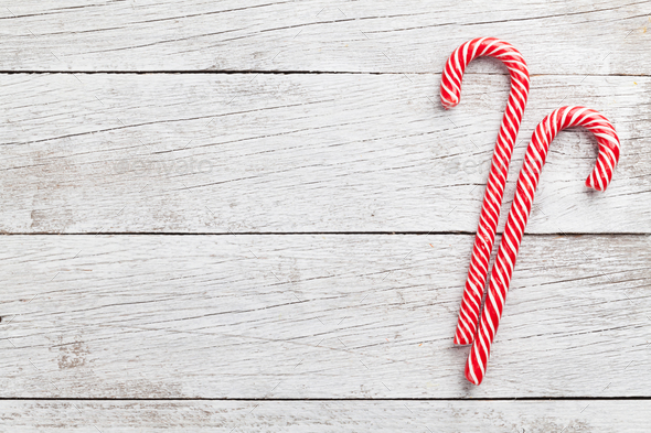 Christmas candy canes on wood - Stock Photo - Images