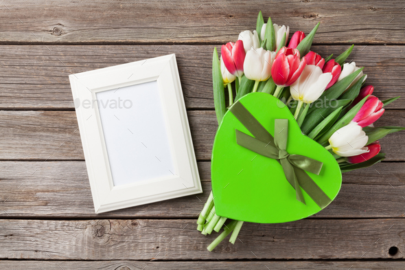 Fresh tulip flowers bouquet and photo frame - Stock Photo - Images
