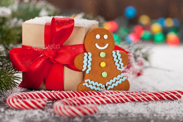 Christmas gift box, candy canes and gingerbread man - Stock Photo - Images