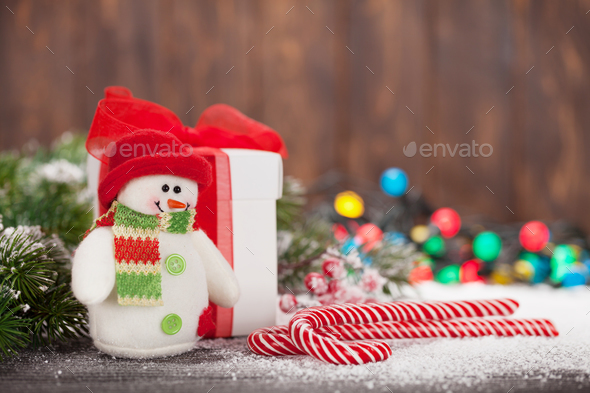 Christmas gift box, candy canes and snowman - Stock Photo - Images