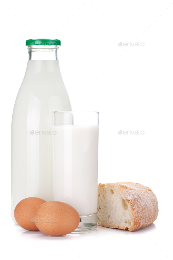 Milk bottle, glass, eggs and bread - Stock Photo - Images