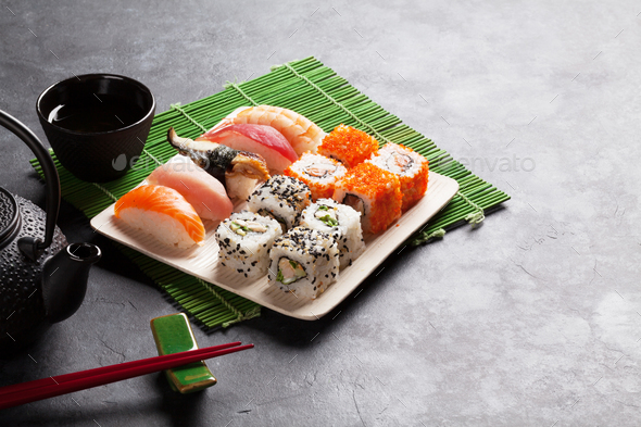 Set of sushi, maki and green tea - Stock Photo - Images
