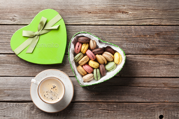 Macaroons in Valentines day gift box and coffee - Stock Photo - Images