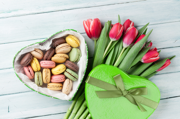 Red tulips bouquet and gift box with macaroons - Stock Photo - Images