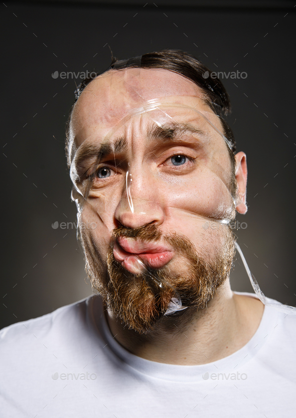 Studio portrait of funny scotch taped man face - Stock Photo - Images