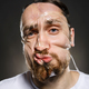 Studio portrait of funny scotch taped man face - PhotoDune Item for Sale